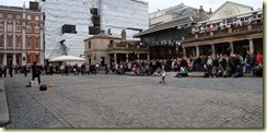 Street performer with a long rope and a little girl in Covent Garden