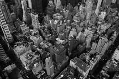 Looking_down_on_New_York_City_by_lowjacker