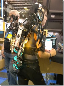 Woman augmented with electronics and wing-claws