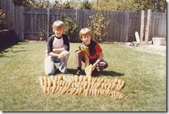 Michael and Brian with a crop of carrots
