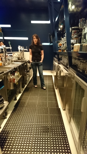 Lorie behind the bar