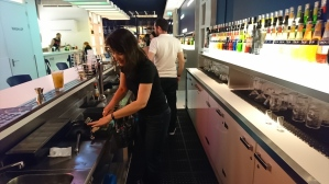 Lorie making a cocktail